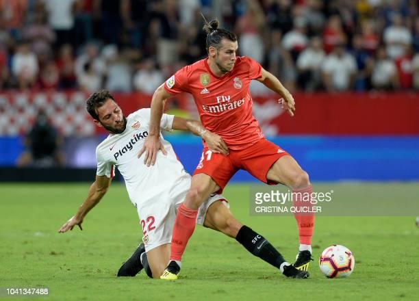Real Madrid's Welsh forward Gareth Bale vies with Sevilla's Italian midfielder Franco Vazquez during the Spanish league football match Sevilla FC...
