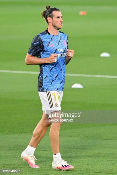 Real Madrid's Welsh forward Gareth Bale warms up before the Spanish league football match real Real Madrid CF against RCD Mallorca at at the Alfredo...