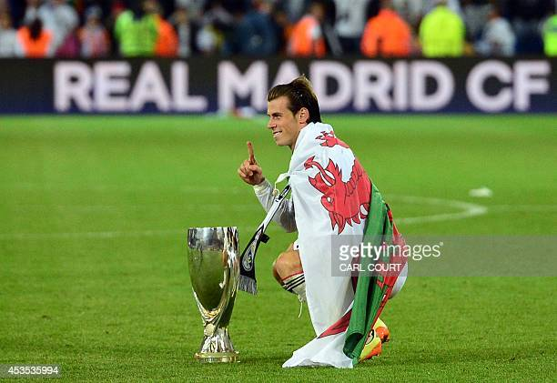 Real Madrids Welsh midfielder Gareth Bale celebrates with the trophy on the pitch after the UEFA Super Cup football match between Real Madrid and...