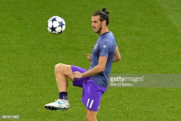 Real Madrid's Welsh striker Gareth Bale warms up prior to the UEFA Champions League final football match between Juventus and Real Madrid at The...