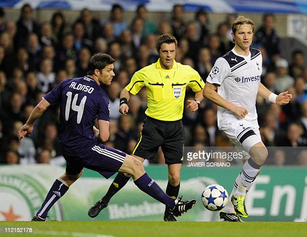 Real Madrid's Xabi Alonso vies with Tottenham Hotspur's Russian player Roman Pavlyuchenko during a UEFA Champions League Quarter Final 2nd leg...