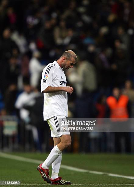 Real Madrid's Zinedine Zidane walks off the pitch following a Spanish league football match against Osasuna at the Santiago Bernabeu stadium in...