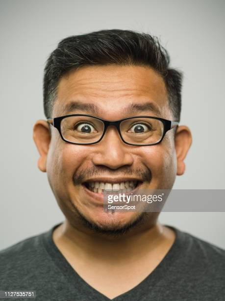 real malaysian adult man with very excited expression - making a face stock pictures, royalty-free photos & images
