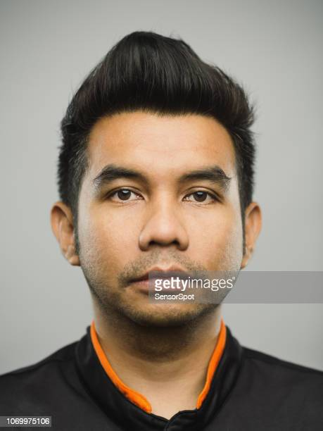 Real malaysian young man with blank expression