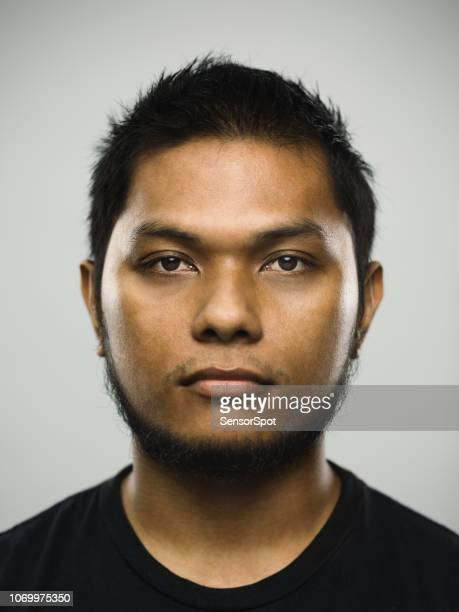 real malaysian young man with blank expression - mug shot stock pictures, royalty-free photos & images