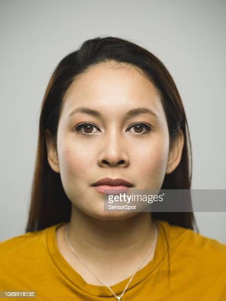 real malaysian young woman with blank expression - police mugshot stock pictures, royalty-free photos & images