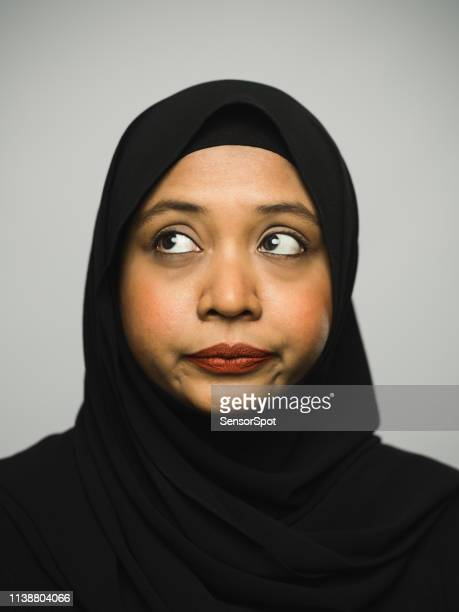 Real malaysian young woman with hijab and negative expression looking to the side