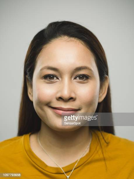 real malaysian young woman with smirking expression - smirking stock pictures, royalty-free photos & images