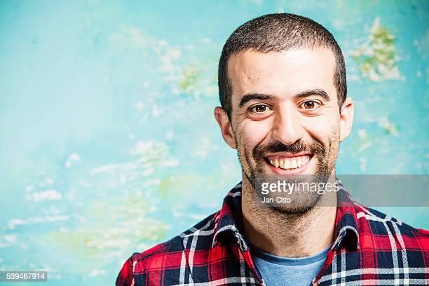 Real man smiling into camera