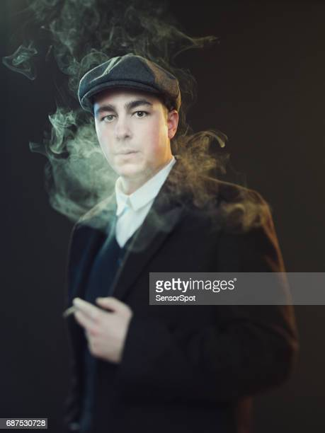 real man smoking in peaky blinders suit - flat cap stock pictures, royalty-free photos & images