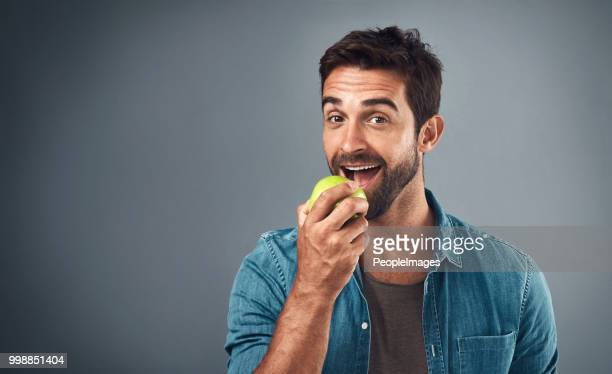 real men eat real food - biting stock pictures, royalty-free photos & images