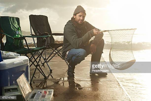 real men go fishing - muscle men at beach stock photos and pictures