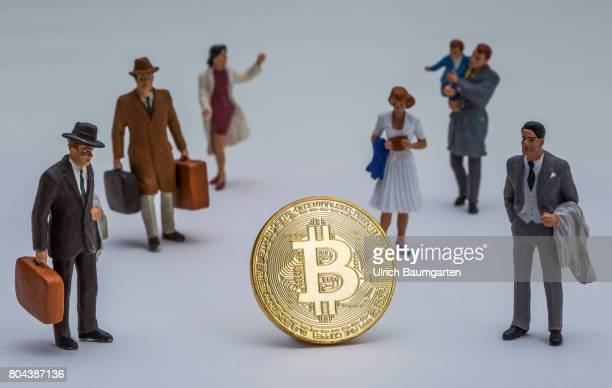 Real money for the population or digital crooks money The photo shows a Bitcoin physically and a group of people
