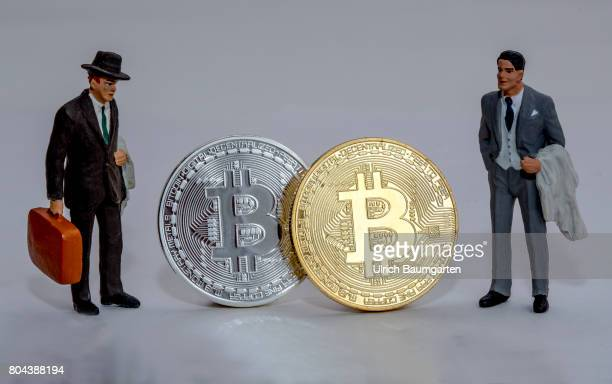Real money for the population or digital crooks money The photo shows Bitcoins physically and manager miniature figures