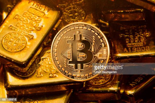 Real money or digital crooks money The photo shows a Bitcoin with gold bars