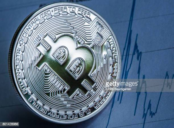 Real money or digital crooks money The photo shows a Bitcoin physically with the course development