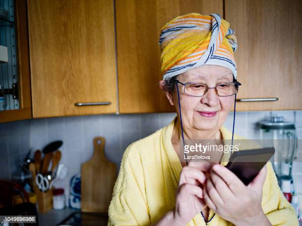 real mother in law in domestic kitchen - grandmother stock pictures, royalty-free photos & images