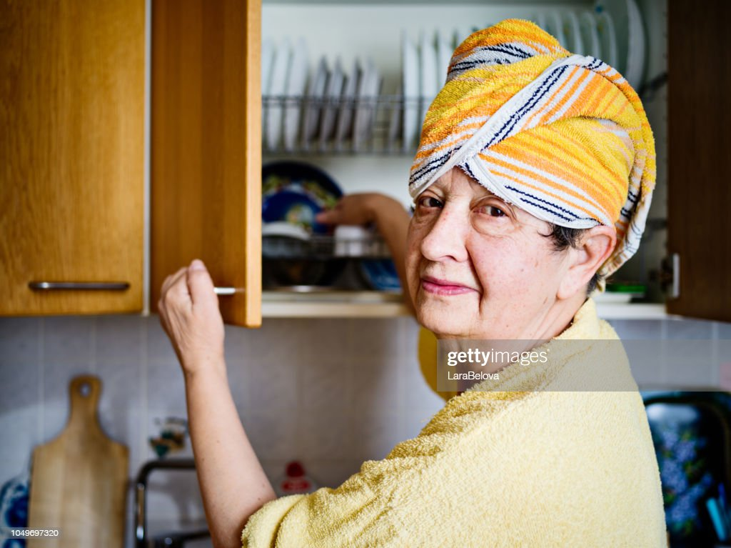 Real mother in law in domestic kitchen : Stock Photo