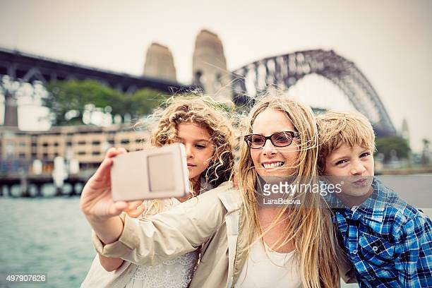 Real mother taking selfie with her kids, Sydney Harbour Bridge