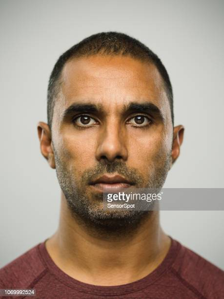 real pakistani man with blank expression - police mugshot stock pictures, royalty-free photos & images