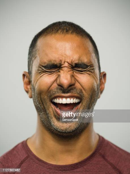 real pakistani man with excited expression and eyes closed - making a face stock pictures, royalty-free photos & images