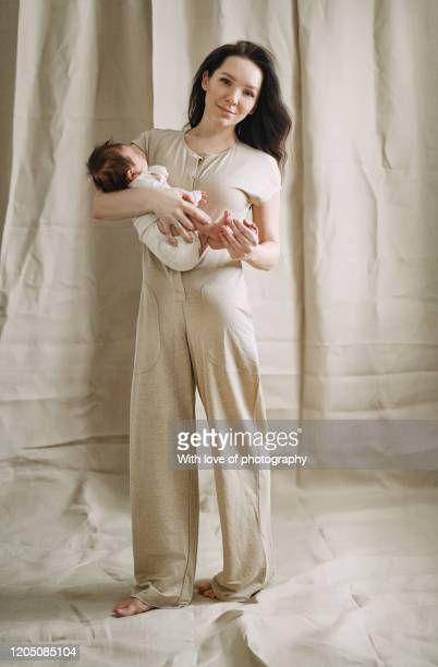 real people beautiful caucasian mother with newborn baby, linen, natural colors, baby mother care, real people, 0-1 months young adult, happiness, maternity, loving mother holding baby, motherhood, femininity, postpartum - 0 1 months stock pictures, royalty-free photos & images