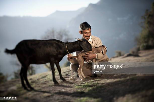 Real people from rural India: Happy man with Goats