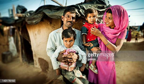 real people from rural india: happy parents with their children. - armoede stockfoto's en -beelden
