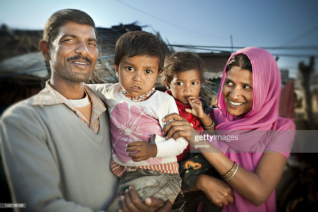 Real people from rural India: Happy parents with their children. : Stock Photo