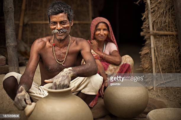 Real people from rural India: Happy potter with his wife.