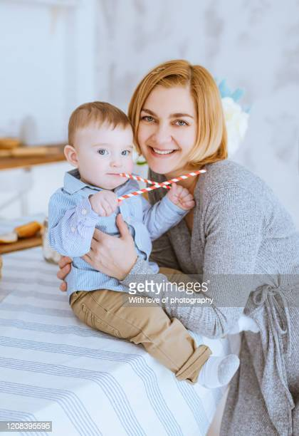 real people, mother cuddling with her baby son under 1 year, baby boy, single mother, mother's day, caucasian, beautiful motheк 30-39 years  with baby - 30 39 years ストックフォトと画像