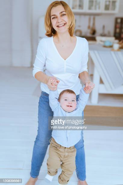 real people, mother playing with her baby son under 1 year, baby boy, single mother, mother's day, caucasian, beautiful motheк 30-39 years  with baby - 30 39 years stockfoto's en -beelden