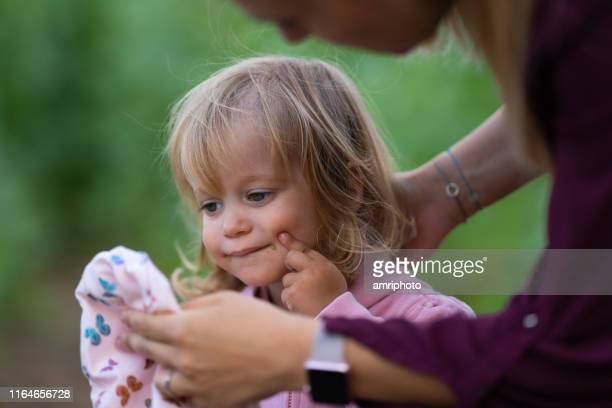 real people real life 2 years old girl candid portrait outdoors - 2 3 years stock pictures, royalty-free photos & images