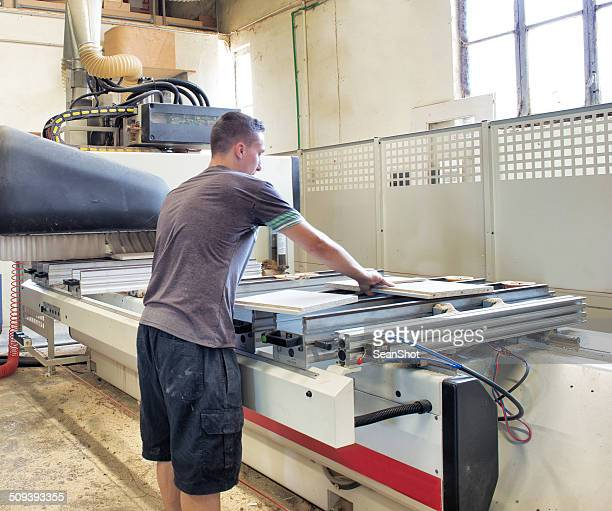real people - worker operating prouction machine - guillotine stock pictures, royalty-free photos & images