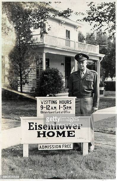 Real photo advertising postcard features future American president Dwight Eisenhower posed in front of his family home Abilene Kansas circa 1945
