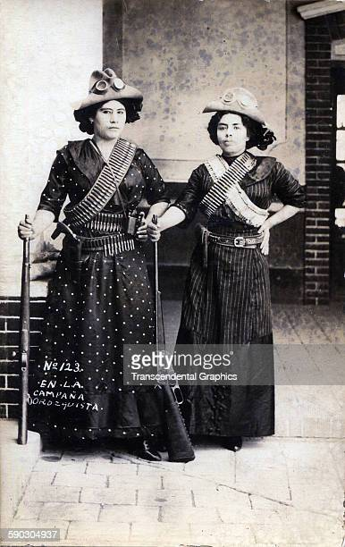 Real photo postcard features a pair of female fighters posing with their rifles during the Mexican Revolution Mexico circa 1910