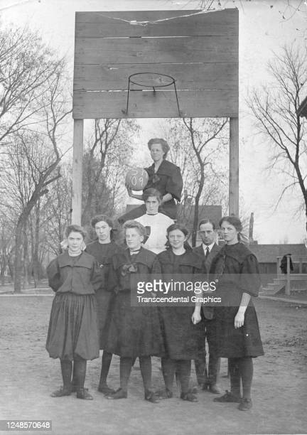 Real photo postcard features portrait of the members of an unidentified high school girlÕs basketball team and their coaches, 1909.