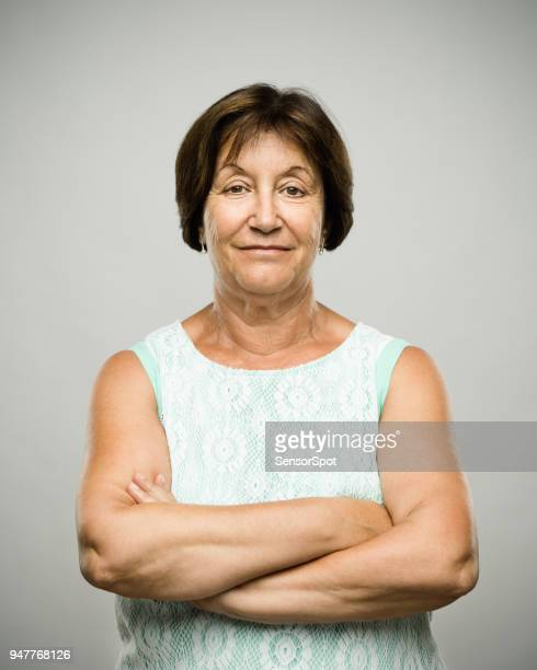 real relaxed senior woman portrait with arms crossed - donna grassa foto e immagini stock