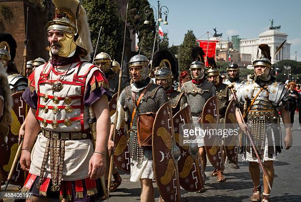 real roman centurion soldiers in a costumes parade - gladiator stock photos and pictures