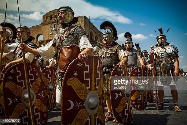 real roman gladiators and centurions in front of the coliseum - roman army stock pictures, royalty-free photos & images