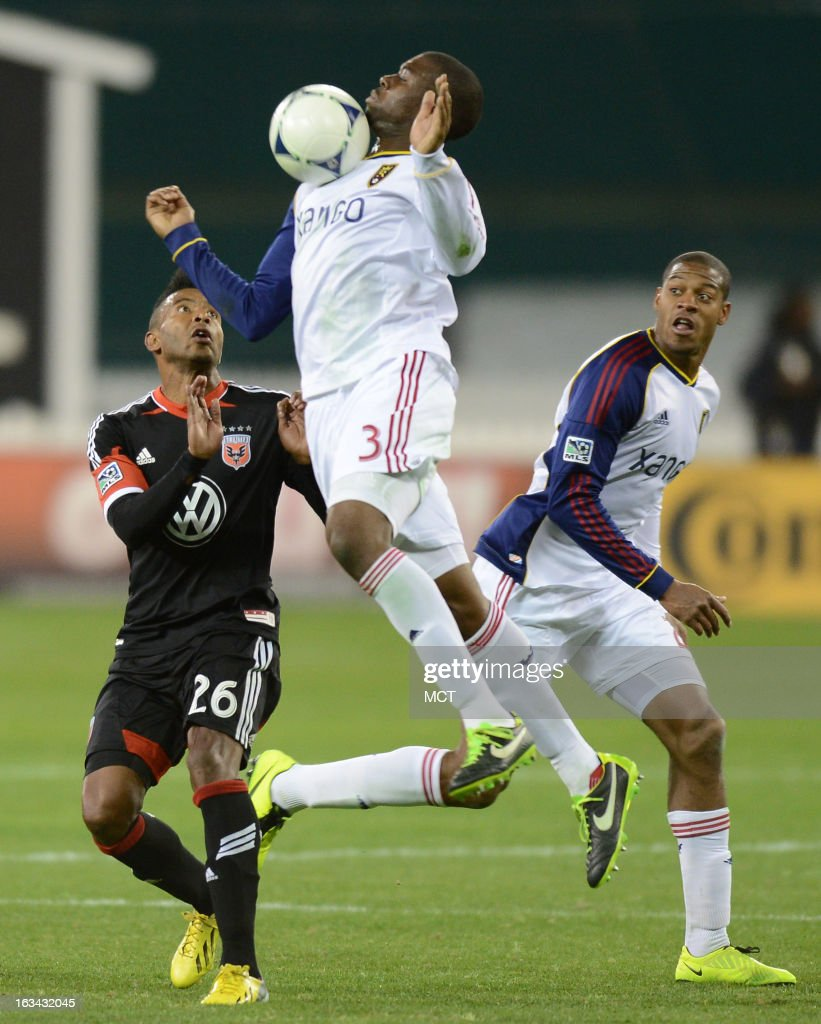 Real Salt Lake defender Tony Beltran (2) makes a play on the ball with his chest over D.C. United forward Lionard Pajoy (26) and Real Salt Lake defender Chris Schuler (28) in the second half at RFK Stadium in Washington, D.C., Saturday, March 9, 2013. United defeated RSL, 1-0.