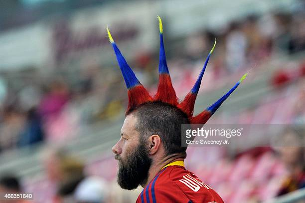 Real Salt Lake fan shows his team's colors with spiked hair during their game against the Philadelphia Union at Rio Tinto Stadium on March 14 2015 in...