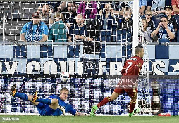 Real Salt Lake forward Juan Martinez scores past Sporting Kansas City goalkeeper Tim Melia on Saturday May 21 at Children's Mercy Park in Kansas City...