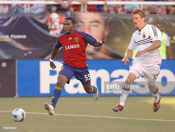 Real Salt Lake forward Robbie Findley scores his first goal of the night against DC United as defender Bobby Boswell watches at Rice-Eccles Stadium...