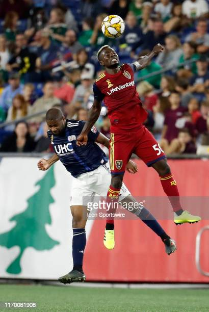 Real Salt Lake forward Sam Johnson beats New England Revolution defender Andrew Farrell in the air during a match between the New England Revolution...