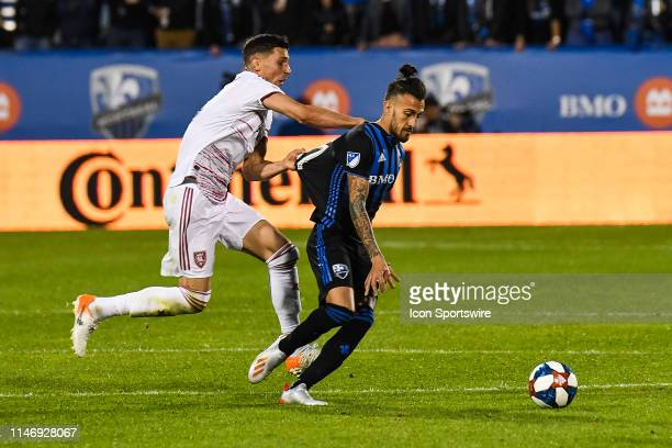 Real Salt Lake midfielder Damir Kreilach pulls on Montreal Impact forward Maximiliano Urruti shirt trying to unbalance him during the Real Salt Lake...