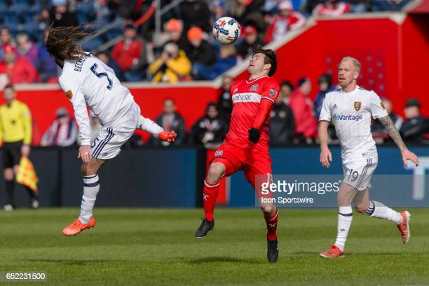 Real Salt Lake midfielder Kyle Beckerman and Chicago Fire midfielder Brandt Bronico play a ball in the second half during an MLS soccer match between...