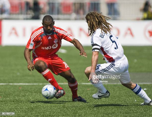 Real Salt Lake midfielder Kyle Beckerman, right, challenges Toronto FC defender Marvell Wynne for the ball during their game on April 19, 2008 at BMO...