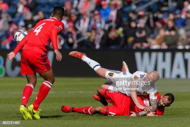 Real Salt Lake midfielder Luke Mulholland falls on Chicago Fire forward Arturo Alvarez in the second half during an MLS soccer match between Real...
