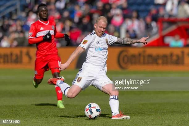 Real Salt Lake midfielder Luke Mulholland kicks the ball in the second half in the second half during an MLS soccer match between Real Salt Lake and...